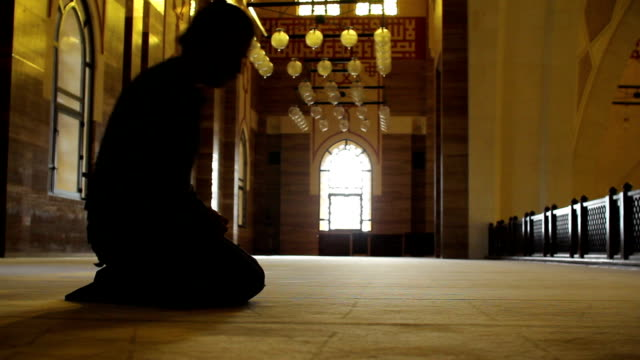 namaz: muslim man worship in mosque video