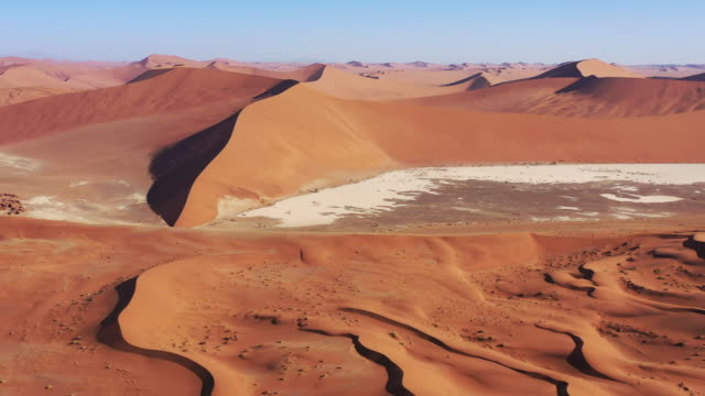 Namb Desert Sand Dunes Sea of Sand Drone 4K Flight Video Namibia Namb Desert Sand Dunes. Drone Aerial Video 4K in Sunset light along the giant Sea of Sand Desert Sand Dunes in the Namib-Naukluft National Park. Sesriem, Namib-Naukluft National Park, Namibia, South West Africa. swakopmund stock videos & royalty-free footage