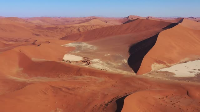 Nambia Desert Sand Dunes Namib-Naukluft National Park Drone 4K Video Video 4K drone flight in warm late afternoon light close to sunset over the large sea of sand desert sand dunes in the Namib-Naukluft National Park. Sesriem, Namib-Naukluft National Park, Namibia, South West Africa. swakopmund stock videos & royalty-free footage