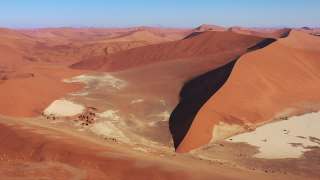 Namibia Dead Vlei Sossusvlei Namb Desert Sand Dunes Drone 4K Flight Video Sossusvlei - Dead Vlei Namb Desert Sand Dunes. Drone Aerial Video 4K in Sunset light along the giant Sea of Sand Desert Sand Dunes in the Namib-Naukluft National Park. Sesriem, Namib-Naukluft National Park, Namibia, South West Africa. swakopmund stock videos & royalty-free footage