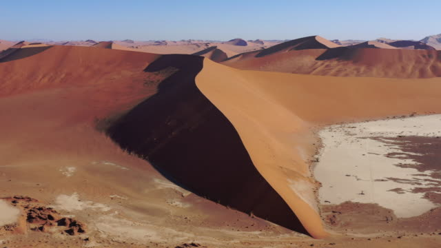 Namibia Desert Sand Dune Namib-Naukluft Drone 4K Video Africa Giant Dead Vlei Namb Desert Sand Dune. Aerial Drone Video 4K Round Flight in the warm dusk light along giant majestic Desert Sand Dunes in the Namib-Naukluft National Park. Sesriem, Namib-Naukluft National Park, Namibia, South West Africa. swakopmund stock videos & royalty-free footage