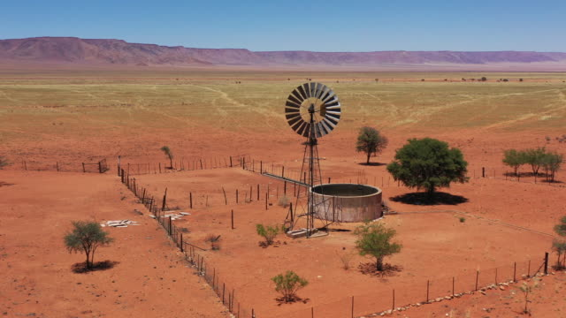 Namibia Rural Farming Wind Turbine Electricity Generator at Waterhole 4K Video