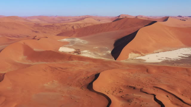 Namibia Sossusvlei Namb Desert Sand Dunes Drone 4K Flight Video Namb Desert Sand Dunes. Drone Aerial Video 4K in Sunset light along the giant Sea of Sand Desert Sand Dunes in the Namib-Naukluft National Park. Sesriem, Namib-Naukluft National Park, Namibia, South West Africa. swakopmund stock videos & royalty-free footage