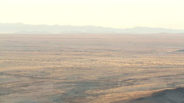 Namibian desert horizon, landscape at sunset, panning shot from mountain top video