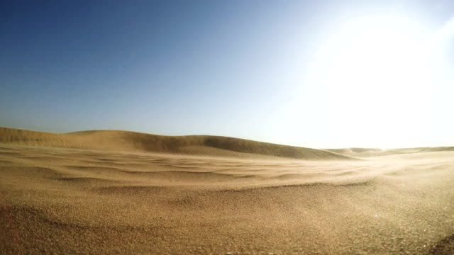 Namibian desert. Sun shining above sand dunes Large space of Namibian desert. Sand falling down the dunes. Sand Storm dry stock videos & royalty-free footage