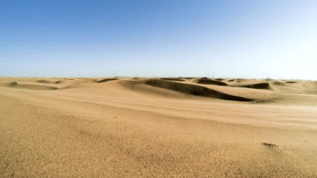Namibian desert. Sun shining above sand dunes video