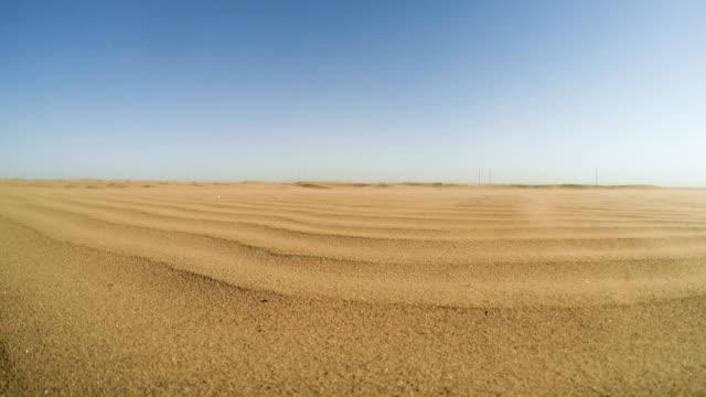 Namibian desert. Sun shining above sand dunes Large space of Namibian desert. Sand falling down the dunes. Sand Storm namibia stock videos & royalty-free footage