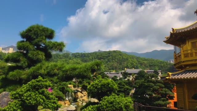 vídeos de stock e filmes b-roll de nan lian temple with high building background - lian empty