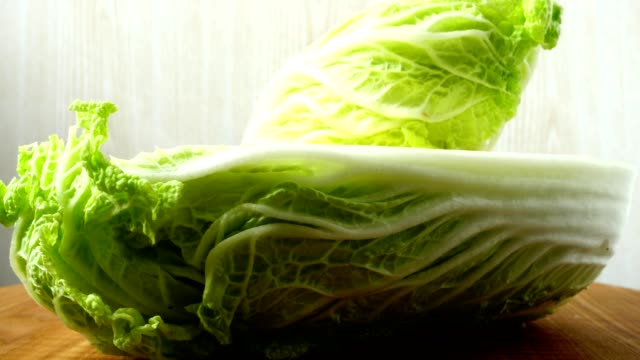 Napa cabbage, shooting in the movement.	Cuttig board. Napa cabbage, shooting in the movement.	Cuttig board. cabbage stock videos & royalty-free footage