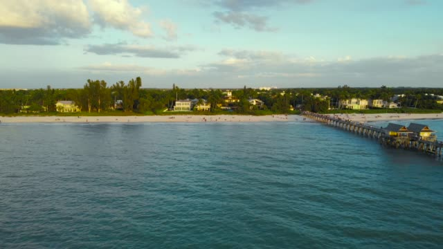 Naples Beach and Fishing Pier at Sunset, Florida video