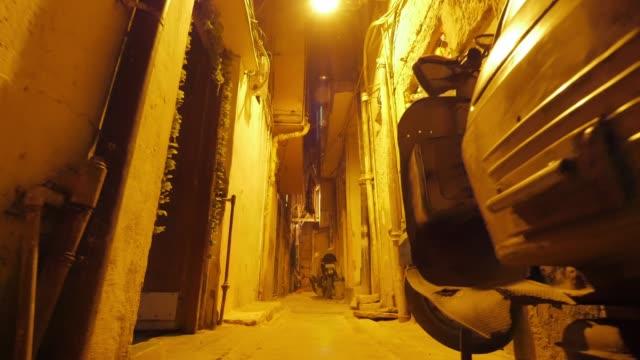 Narrow back street of Delhi, India. Slow motion dolly shot