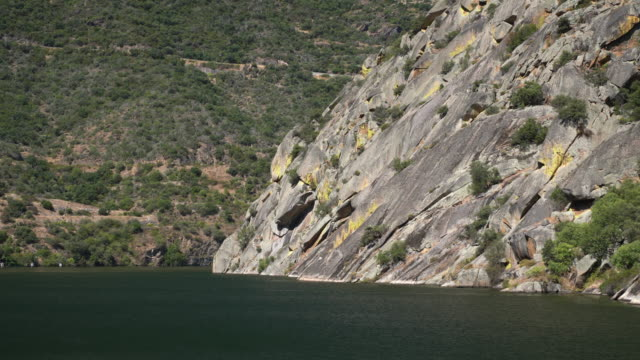 Narrow canyon with steep rocky sides on the river Douro in Northern Portugal on a cruise boat voyage - video