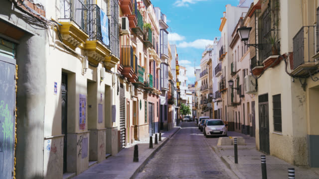 narrow empty street in europe with balconies in andalusia, spain - balcone video stock e b–roll