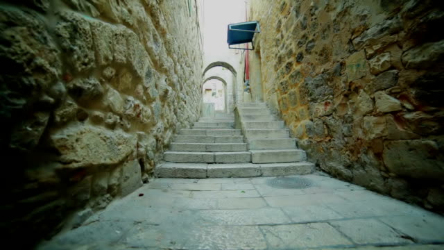 Narrow street in old city. Staircase and arches. video