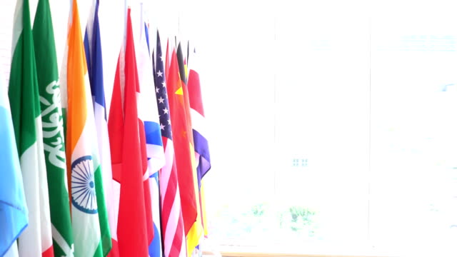 national flag is in front of big window
