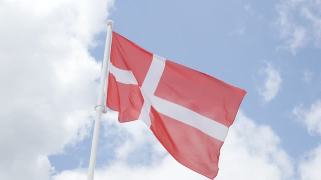 National flag of Denmark in front of cloudy sky waving 4K 2160p 30fps UHD footage - Red Danish flag fabric on the wind 4K 3840X2160 UltraHD video National flag of Denmark in front of cloudy sky waving 4K 2160p 30fps UHD footage - Red Danish flag fabric on the wind 4K 3840X2160 UltraHD video denmark stock videos & royalty-free footage