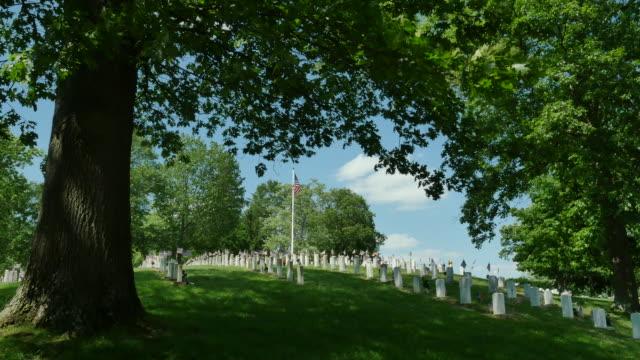 National Veterans Cemetery Under Oak Tree Blowing Flag 4k video