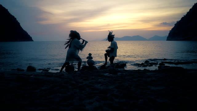 Native American Men Have Fun on Beach
