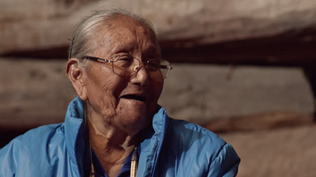 A Native American (Navajo) Woman in Her Eighties Talks to and Laughs with a Man in His Forties while They Eat