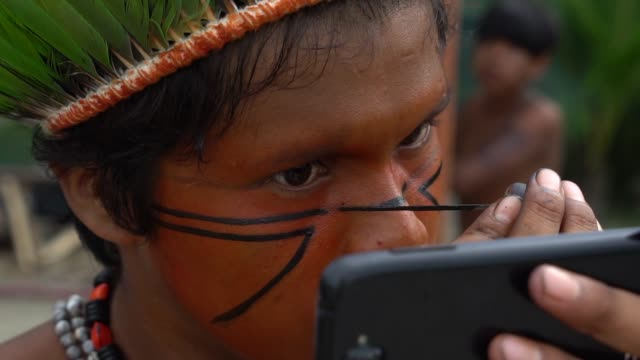 Native Brazilian Indigenous painting face, Brazil video