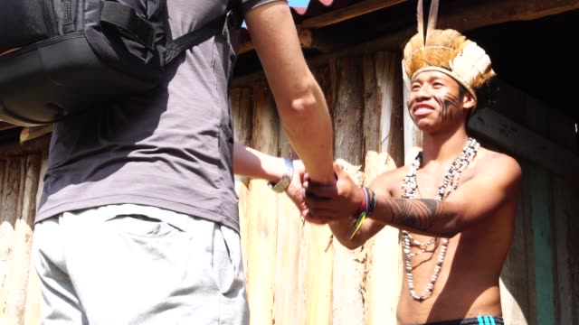 Native Brazilian Welcoming the tourist on Brazilian Indigenous Tribe, from Guarani ethnicity video