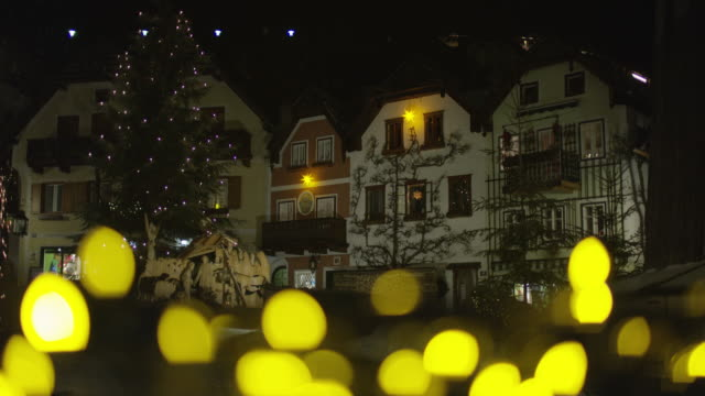 Nativity scene and buildings at night