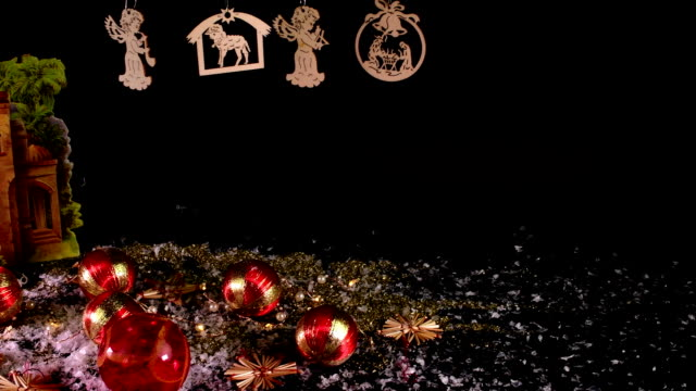 Nativity scene and Christmas collection on black background. Christmas decoration. Christmas balls. video
