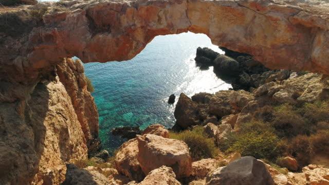 Natural bridge stone arch near Ayia Napa, Cyprus.  Aerial drone shot. 4K 60fps ProRes