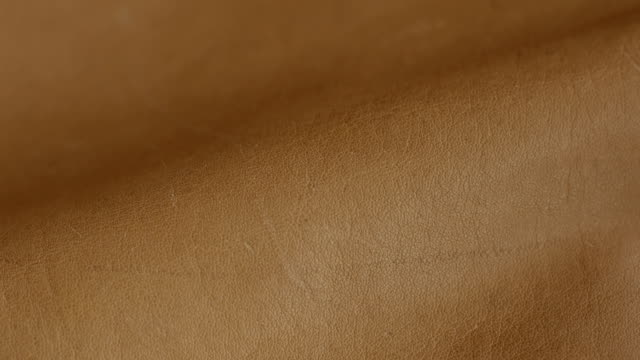 Natural brown leather texture background. Abstract vintage cow skin backdrop design. video