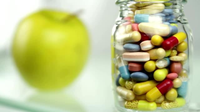 Natural Fruit versus Bottle of Pills Healthy or Artificial video