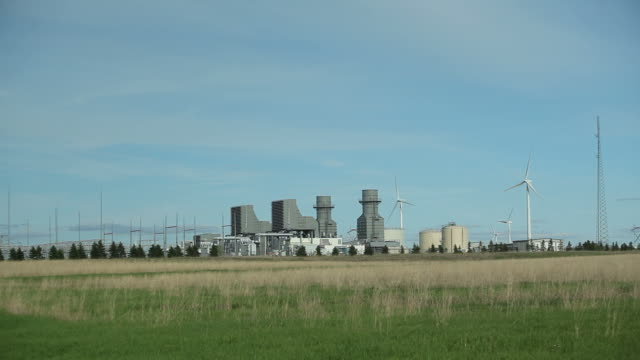 Natural Gas 400 Megawatt Electricity Peaking Plant with Wind Turbines video