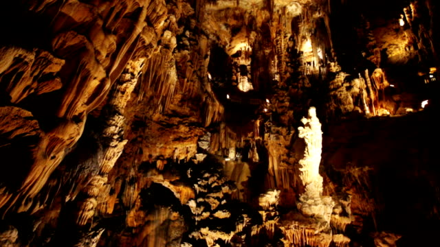 natural rock formations in grotte des demoiselles - speleologia video stock e b–roll