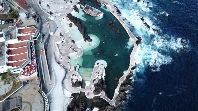vídeos de stock e filmes b-roll de natural volcanic pools at porto moniz, madeira island - ilha da madeira