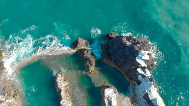 Natural volcanic swimming lagoon in rocks, wild pools for relaxing, travel destination for vacation, Madeira island, Portugal