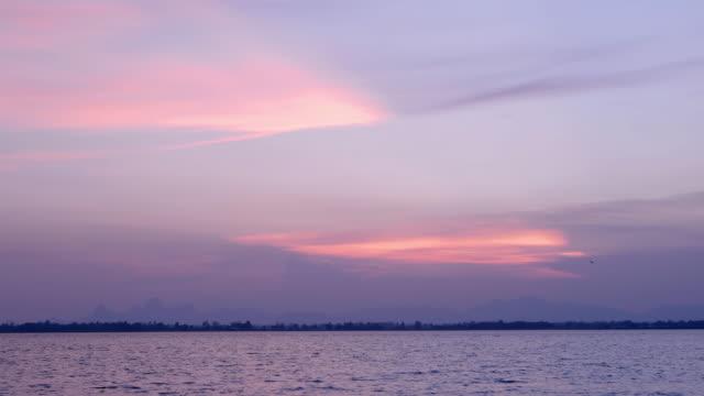 nature background. moments after sunset. sky, lake - badawczy statek kosmiczny filmów i materiałów b-roll