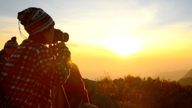 Nature photographer on the top of mountain video