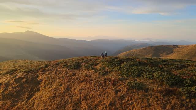 Nature photographers meet sunrise on the mountain top