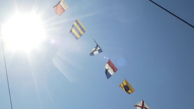 Nautical Flags Against Blue Sky video