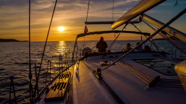 WS Navigating A Sailboat At Dusk video