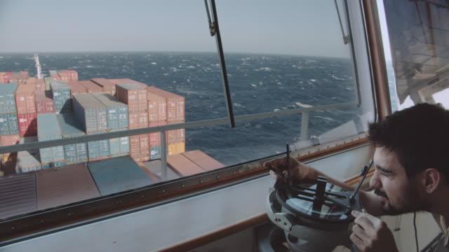 Navigation officer calculating compass error