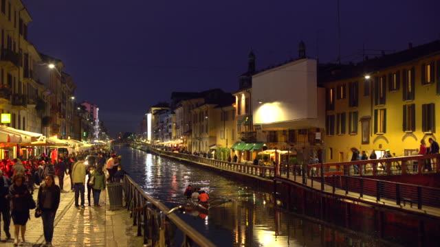 naviglio grande canal i milano - walking home sunset street bildbanksvideor och videomaterial från bakom kulisserna