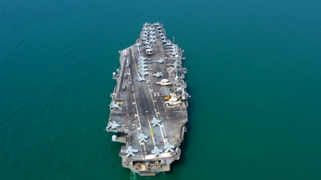 Navy Nuclear Aircraft carrier, Military navy ship carrier full loading fighter jet aircraft, Aerial view, 4K.