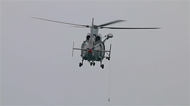 Navy seals training rescue people in the open sea with flying helicopter video