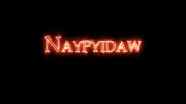 naypyidaw written with fire. loop - naypyidaw video stock e b–roll