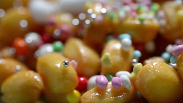 vídeos de stock e filmes b-roll de neapolitan  sweets candies - christmas cake