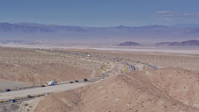 I-15 Near Zzyzx, Heading to Baker - Drone Shot Drone shot of Interstate 15, a divided highway crossing the Mojave Desert near the town of Zzyzx. The town of Baker is visible in the distance. mojave desert stock videos & royalty-free footage