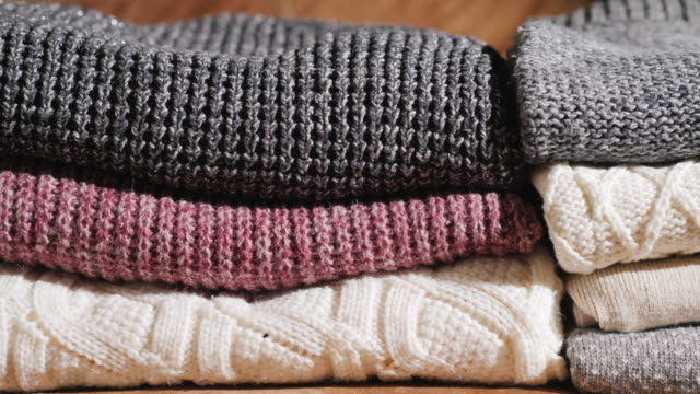 Neatly folded warm winter clothes video