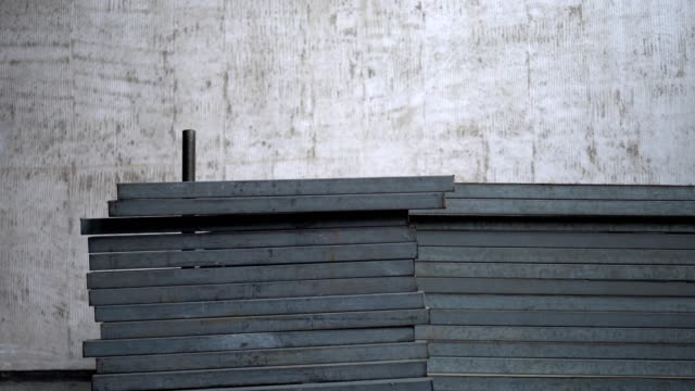Neatly stacked metal materials for construction at the construction site.