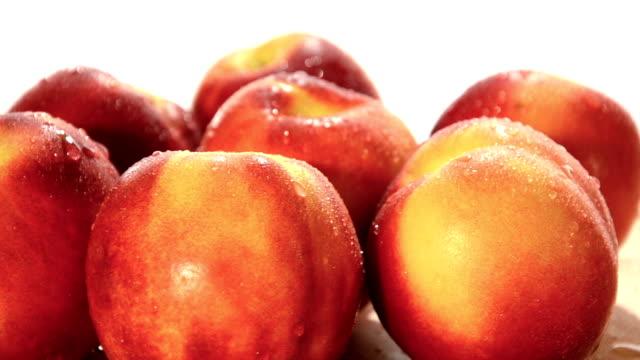 nectarines nectarines on white background nectarine stock videos & royalty-free footage