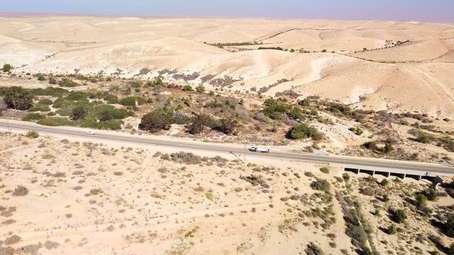 Nedium distance approach to highway with bridge in desert